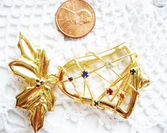 Christmas pin brooch gold tone bell with rhinestones and holly leaves