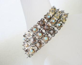 very old vintage flat wide bracelet with tiny little turquoise cabs