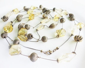 very very long vintage necklace with spaced antiqued goldtone and faceted beads