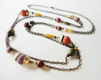 long vintage double chain necklace with spaced beads in a gold tone