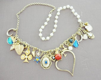 chunky charm necklace lots of vintage charms gold and pearls chain