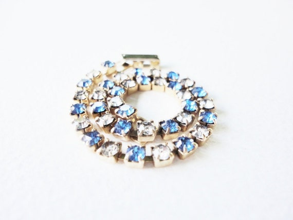 vintage jewelry sarah coventry clear and blue rhinestones bracelet on a gold tone