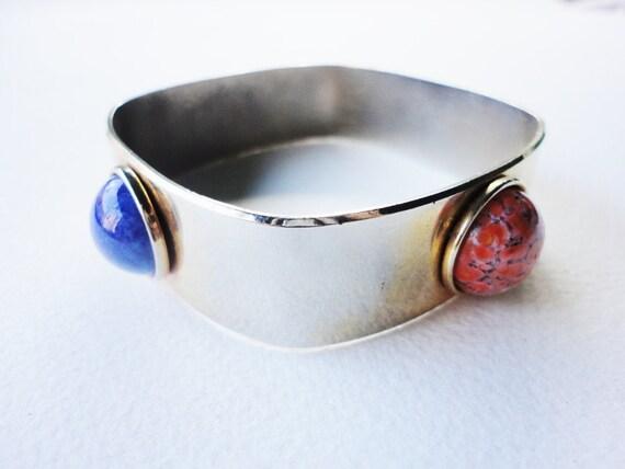 vintage wide geometric bangle bracelet in a solid goldtone with gemstones cabochons