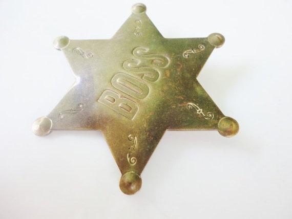 vintage star badge BOSS brooch by Lowell Sigmund Inc. 1978