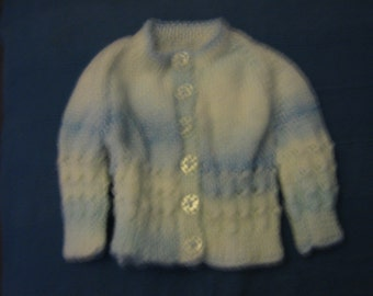 A BABY BOYS HANDKNITTED ROUND NECK CARDIGAN
