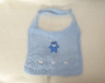 a light blue babys bib