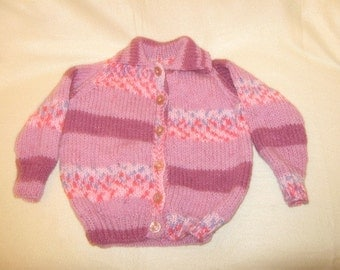 a chunky knit childs sweater