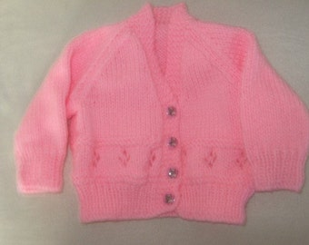 a pink babys sweater