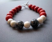 Red coral, snowflake obsidian, and howlite bracelet