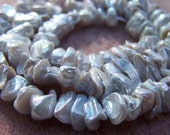 Keshi pearls half strand white with silver shimmer - 5357