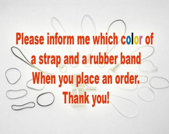 Strap with rubber band to carry or ring to wear