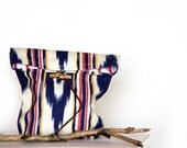 Ethnic pattern Ikat print pouch in navy blue and red with twig button