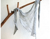 Shredded Triangle Scarf in Light Grey.
