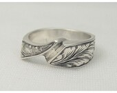 Sterling silver  ring, engraved half way round by  hand