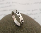Hand stamped message ring in sterling silver.