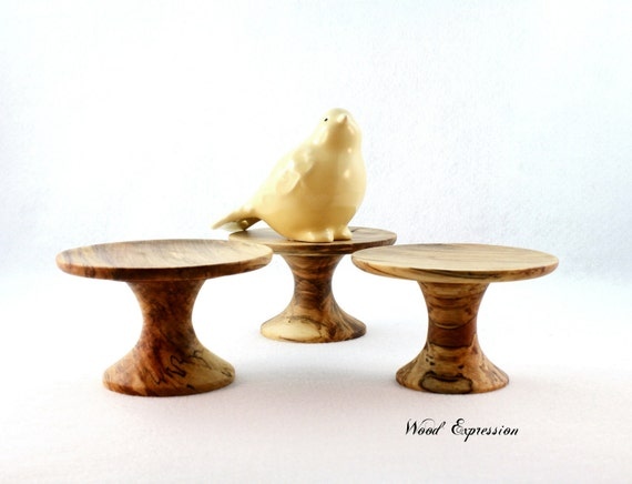 Set of three pedestal stands/ Candle holders