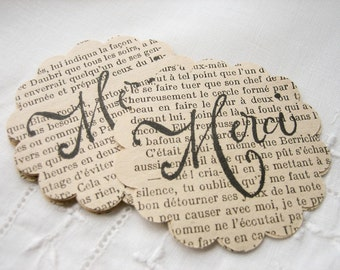 Merci scalloped circles cut from Vintage French novels