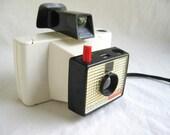 meet the swinger - super mod space age 60s Polaroid Swinger camera
