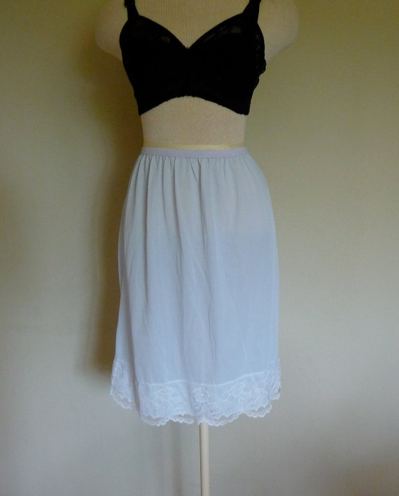 Vintage unworn new with tags Periwinkle Blue nylon and chantilly lace half slip from Bentley Lingerie, size 10, medium