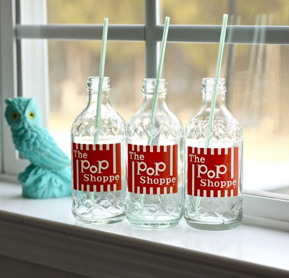 vintage collection of soda bottles Pop Shoppe red and white stripes