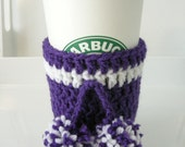 blissthings coffee cozy with pom poms in purple and white