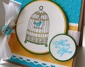 Embossed Turquoise and Yellow Here for You card with Birdcage