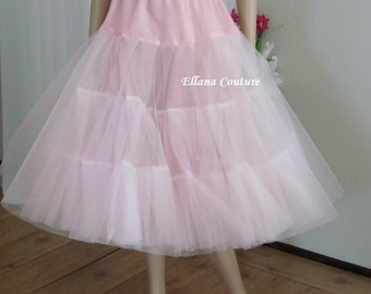 Pink Tea Length Crinoline. Medium Fullness. Designed specifically for Tea Length Dresses. Available in Other Colors.