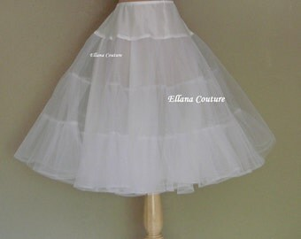 Tea Length Crinoline. Medium Fullness Petticoat. Designed specifically for our Tea Length Dresses. Available in Several Colors.