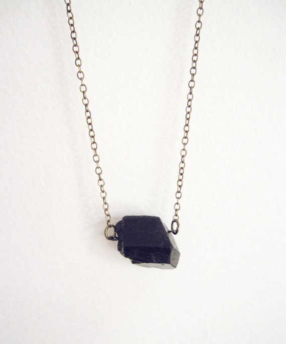 raw black tourmaline crystal chunk necklace on antiqued brass