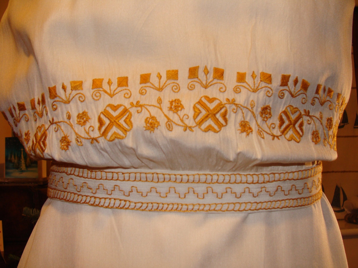 Cream silk 1920s to 1930s dress with ethnic motif embroidery
