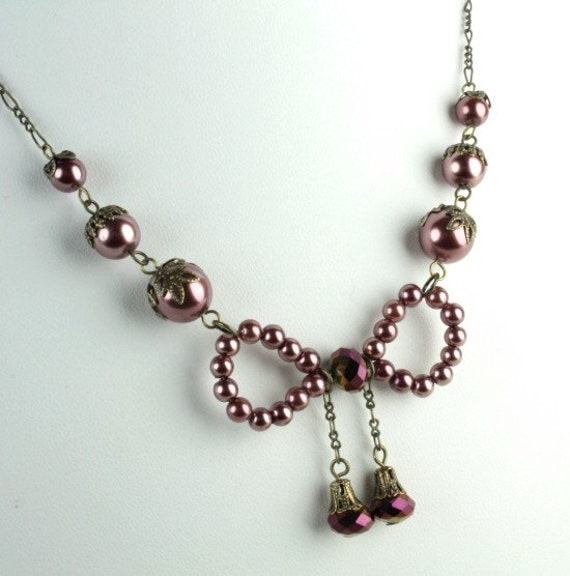 Cranberry Pearl and Crystal Bow Necklace on Antique Brass Chain