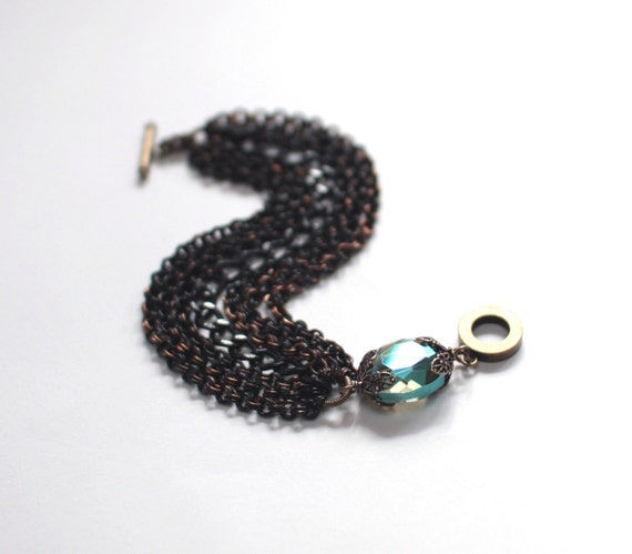 Black Enameled Multistrand Chain Bracelet with Peacock Green Faceted Crystal Pillow