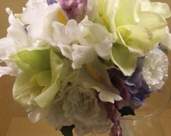 Lisianthus, cymbidium orchids, freesia, iris and hydrangea bridal bouquet
