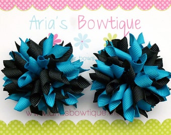 A Pair Of Turquoise And Black Mini Korkers