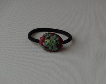 Green frog glass lampwork bead, ponytail holder, red with white polka dots