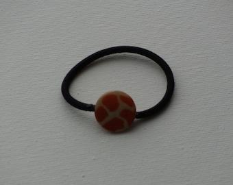 Mother of pearl, orange giraffe print coin bead, ponytail holder