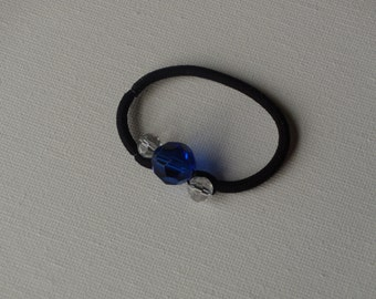 Faceted blue & clear round glass beads, ponytail holder