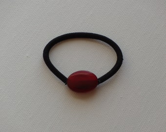 Red acrylic oval bead, ponytail holder