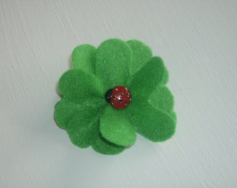 Green large flower hair alligator clip with red ladybug button