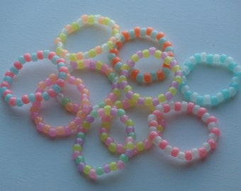 "Set of 10 kids ""glow in the dark"" bead bracelets, rainbow of colors, made by Becca, 8 years old"