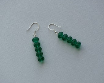 Sterling silver dangle earrings with green vintage glass beads