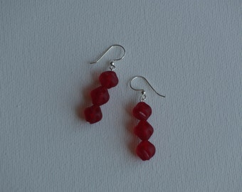 Sterling silver dangle earrings with red glass round dimpled vintage beads