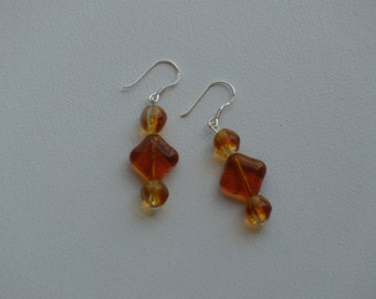 Sterling silver dangle earrings with golden amber glass vintage beads