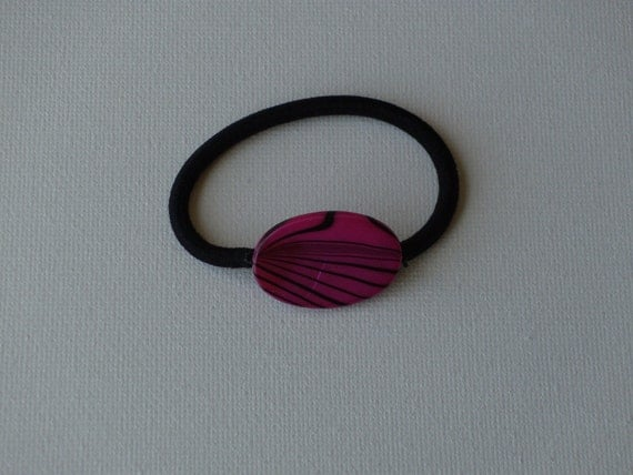 Bright pink with black zebra stripes oval mother of pearl bead, ponytail holder