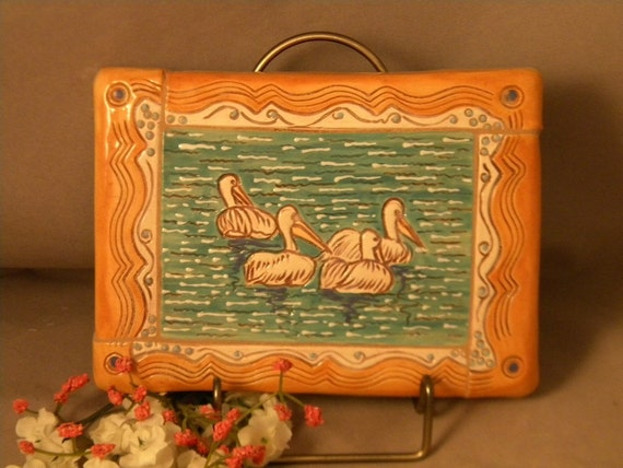 4 Pelicans Swimming Wall Tile