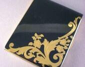 Vintage 1940's Elgin American compact- black and gold enamel