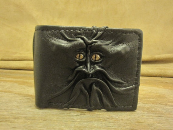 Grichels leather bi-fold wallet - black with bronze speckled slit pupil reptile eyes