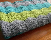 Baby blanket in turquoise, lime green and gray