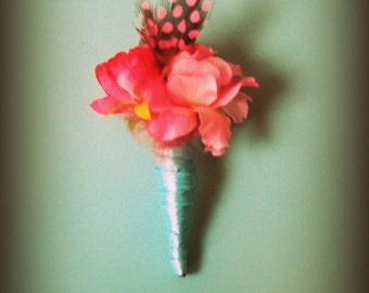 cherry blossom and pink guinea feather boutonniere