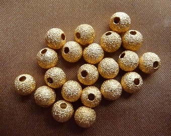 Bead, gold plated brass, 6mm, stardust, round, with 1.7mm hole, Pkg Of 10